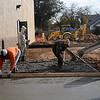 Rick Lorenz Construction workers skreet concrete on the new Pizza Hut drive-thru Thursday, Nov. 14, 2013. The business will soon open at Broadway Plaza. (Staff Photo by BONNIE VCULEK)