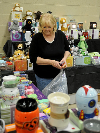 Sandy Hladik, a Scentsy and Velata independent consultant, fills a customer's order as the Officers' Spouses' Club at Vance Air Force Base hosts the Holiday Marketplace at the Chisholm Trail Pavilion Saturday, Nov. 9, 2013. (Staff Photo by BONNIE VCULEK)