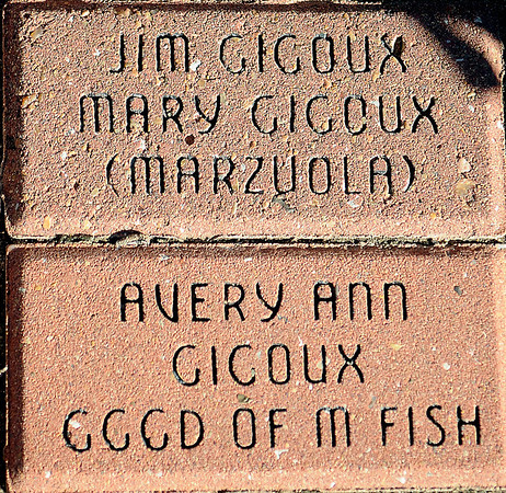 Personalized pavers honor the Gigoux family heritage at Humphrey Heritage Village. Jim and Mary Jane (Marzuola) Gigoux (from left) invited their sons, Gerald and Jeffrey, and their families to Enid for Thanksgiving, so they could experience part of their heritage. (Staff Photo by BONNIE VCULEK)