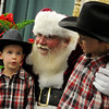 Jake and Caleb Currier visit with Santa during the Home for the Holidays Home Show at the Chisholm Trail Expo Center Saturday, Nov. 23, 2013. (Staff Photo by BONNIE VCULEK)