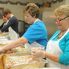 Susie Hinkle, her son, Stephen, Sue Norrie and Terry Pitchford debone eighteen 20 pound turkeys as they prepare for the annual Thanksgiving dinner at the First Baptist Church Wednesday, Nov. 27, 2013. The meal begins at 11 a.m. and will be served until 1 p.m. Thursday. (Staff Photo by BONNIE VCULEK)