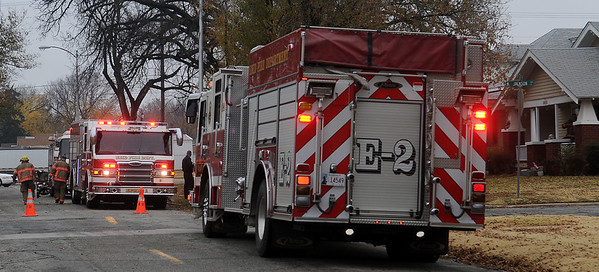 Enid Firefighters respond to a fire at 902 W. Elm Thursday, Nov. 21, 2013. An item was accidentally left on a floor furnace inside the home, filling the residence with smoke, so firefighters remained on the scene until the smoke was cleared. (Staff Photo by BONNIE VCULEK)