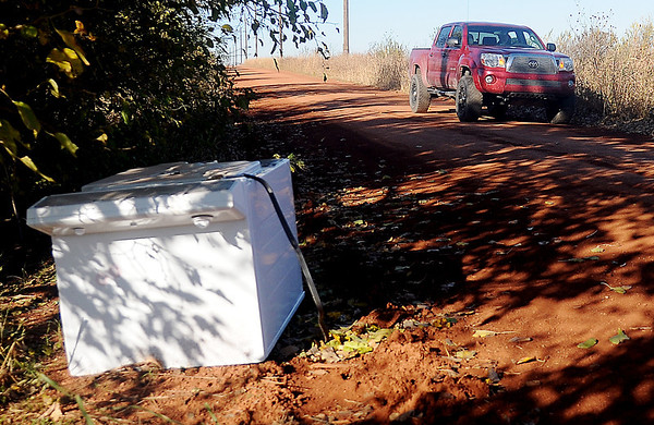 A driver travels east on Skeleton Road after someone illegally dumped a washing machine along the side of the road one-quarter mile east of U.S. 81. The Garfield County Sheriff Department patrols rural areas for individuals who willfully violate the law. (Staff Photo by BONNIE VCULEK)