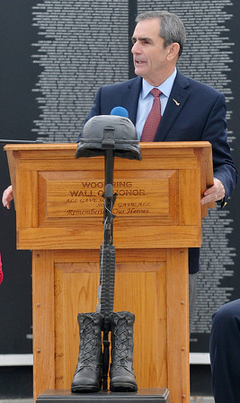 Keynote speaker, Leon Ellis, Col. USAF, Retired, during a retirement and dedication ceremony for the Vietnam Memorial Wall Monday at Woodring Airport. (Staff Photo by BILLY HEFTON)