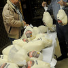 Leroy Patocka (left) and Al Patocka unpack 380 pounds of turkey at the Knights of Columbus Lodge 1044 on W. Willow Friday, Nov. 22, 2013. The National Wild Turkey Federation, Cherokee Strip Chapter donated 200 pounds of the meat for the Knights of Columbus Thanksgiving Day meal at St. Francis Xavier Catholic Church's Leven Center. The members prepare and serve the feast to more than 400 each year. (Staff Photo by BONNIE VCULEK)