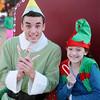 Evan Chermack and Lillian Kaiser await Santa's arrival during Enid Lights Up the Plains Friday, Nov. 28, 2014. (Staff Photo by BONNIE VCULEK)