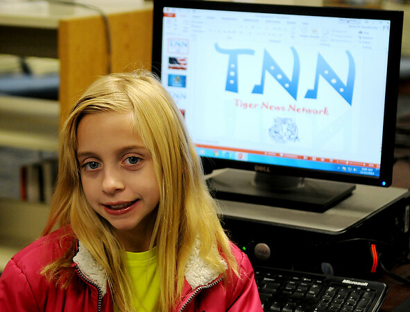Alyssa Johnson pauses next to the Taft Tiger Network computer Wednesday, Nov. 12, 2014. Under the direction of Susan Shewey, Taft Elementary School media specialist, Johnson produces the program with different news anchors each day. (Staff Photo by BONNIE VCULEK)