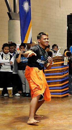 John Jibok, president of the EHS Islander Club, performs a traditional dance during the 2nd Annual Enid High School Islander Night sponsored by the EHS Islander Club November 13 at the high school cafeteria. (Staff Photo by BILLY HEFTON)