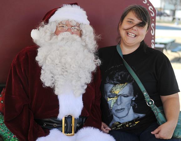Bonita James pauses for a portrait with Santa Saturday, Nov. 29, 2014. (Staff Photo by BONNIE VCULEK)