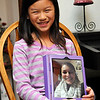 Meleah Meyer an ipad that she is using to talk to her older sister, Rachel, prior to an interview on adoption November 18. (Staff Photo by BILLY HEFTON)
