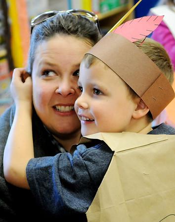 Asher Abbott hugs his mother, Kerri, during the kindergarden Thanksgiving feast at Prairie View Elementary School Tuesday, Nov. 25, 2014. (Staff Photo by BONNIE VCULEK)
