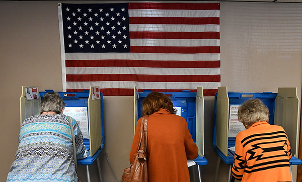 A trio of women cast their ballots during early voting at the Garfield County Election Board Thursday November 3, 3016. (Billy Hefton / Enid News & Eagle)