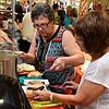 Verna Koehn and Sandy Gragg Charleen Williams assemble bratwurst and sauerkraut during the Oklahoma Mennonite Relief Sale Saturday November 5, 2016 at the Garfield County Fairgrounds. (Billy Hefton / Enid News & Eagle)