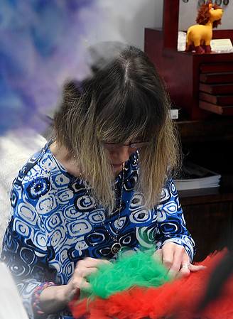 Jennifer Lorenz works on a Christmas wreath at the Second Story Gift Shop Monday November 6, 2016 in downtown Enid. (Billy Hefton / Enid News & Eagle)