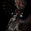 """Fireworks go off behind the Harold Holden sculpture """"Boomer"""" during the Light Up the Plains event kicking off the holiday season Friday November 25, 2016 in downtown Enid. (Billy Hefton / Enid News & Eagle)"""