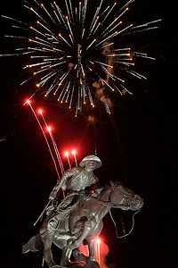 "Fireworks go off behind the Harold Holden sculpture ""Boomer"" during the Light Up the Plains event kicking off the holiday season Friday November 25, 2016 in downtown Enid. (Billy Hefton / Enid News & Eagle)"