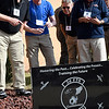 Former members of the 3rd Flying Training Squardron look for their names on the back of a plaque following a ceremony honoring the squardron on it's 100th anniversary Friday November 4, 2016 at Vance Air Force Base. (Billy Hefton / Enid News & Eagle)