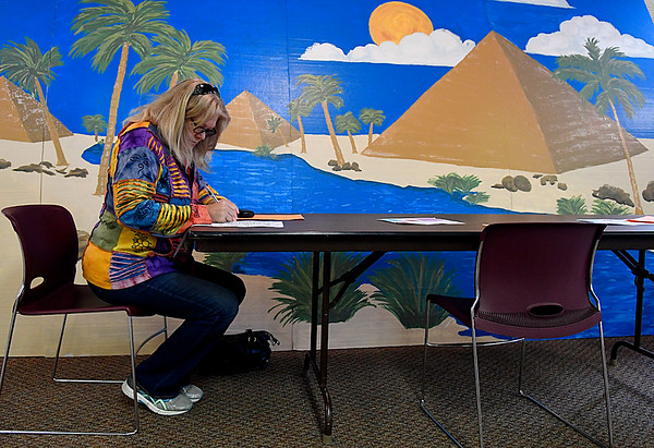 Anne Gerszewski fills out her election ballot in front of a bible school prop at the Carrier Congregational Church Tuesday November 8, 2016. (Billy Hefton / Enid News & Eagle)