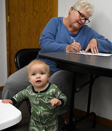 Mary Jo Fleer fills out her election ballot with gradson, Slade Fleer, at the Drummond Fire Department Tuesday November 8, 2016. (Billy Hefton / Enid News & Eagle)