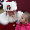 Mailey Ullrich has a talk with Santa during the Light Up the Plains event kicking off the holiday season Friday November 25, 2016 in downtown Enid. (Billy Hefton / Enid News & Eagle)