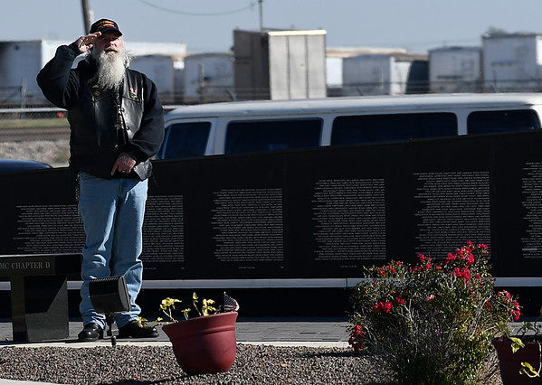 A veteran salutes during the national anthem during the Vereran's Day Rememberance ceremony at the Vietnam Memorial Wall at the Woodring Wall of Honor and Veteran's Park November 11, 2016. (Billy Hefton / Enid News & Eagle)