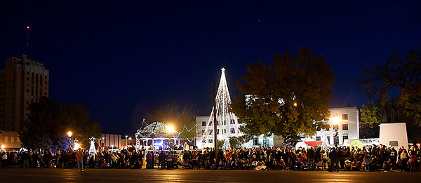 Spectators line Randolph St. as they wait for the start of the Light Up the Plains parade to start Friday November 25, 2016. (Billy Hefton / Enid News & Eagle)