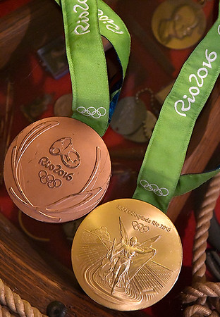 The gold and bronze medals David Plummer won at the 2016 Summer Olympics in Rio de Janeiro. (Billy Hefton / Enid News & Eagle)