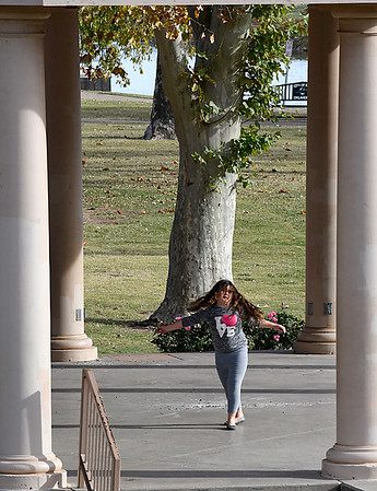 Hailey Fowler twirles around on the stage of the gazebo at Government Springs Park Monday November 21, 2016. (Billy Hefton / Enid News & Eagle)