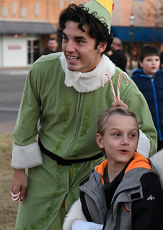 An elf has some fun during Light Up the Plains Friday November 25, 2016. (Billy Hefton / Enid News & Eagle)