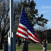 Airmen lower the flag during a Veteran's Day retreat ceremony at Vance Air Force Base Thursday November 10, 2016. (Billy Hefton / Enid News & Eagle)