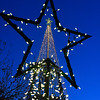 The top of the light tree on the Garfield County Courthouse lawn is seen through the star of a small tree during Light Up the Plains Friday November 25, 2016. (Billy Hefton / Enid News & Eagle)
