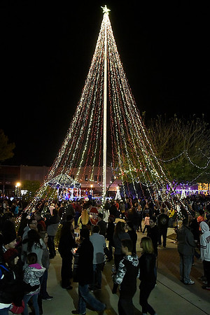 People mill around the Garfield County Courthouse lawn during Light Up the Plains Friday November 25, 2016. (Billy Hefton / Enid News & Eagle)
