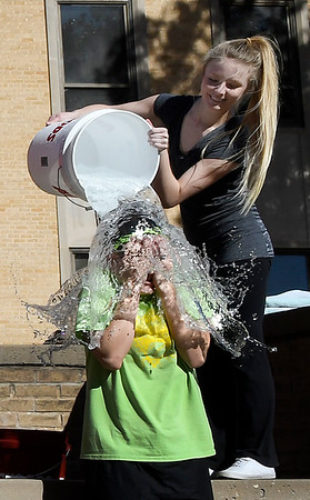 Sienna Sanders dumps a bucket of ice water on Bridgett Zahnow as NOC Enid students took part in the ALS Ice Bucket Challenge Tuesday November 22, 2016. (Billy Hefton / Enid News & Eagle)