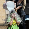 Sienna Sanders dumps a bucket of ice water on Bridgett Zahnow as NOC Enid students took part in the ALS Ice Bucket Challenge Tuesday November 22, 2016. (Billy Hefton / Enid News & Eagle)