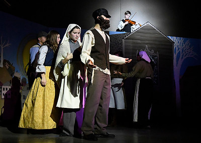 Cast members rehearse a song in the Oklahoma Bible Academy production of Fiddler on the Roof Thursday November 16, 2017. (Billy Hefton / Enid News & Eagle)