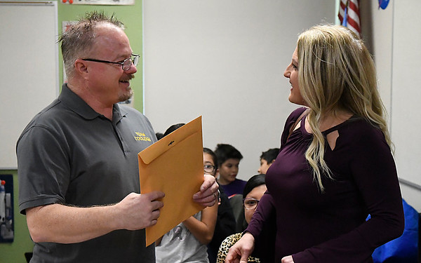 Janna jackson (right) presents Coolidge Elementary teacher, Roy Bartnick, with a grant from the Enid Public Schools Foundation Friday November 17, 2017. (Billy Hefton / Enid News & Eagle)