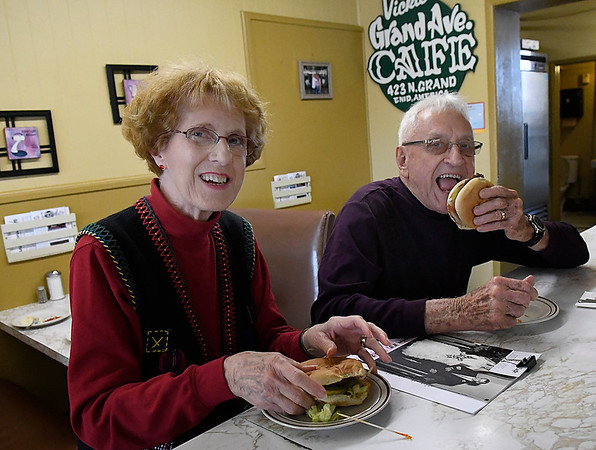 Joan and Larry Zerger have a hamburger at the counter of what is now Grand Avenue Cafe where they had a hamburger on their wedding day 60 years ago. (Billy Hefton / Enid News & Eagle)