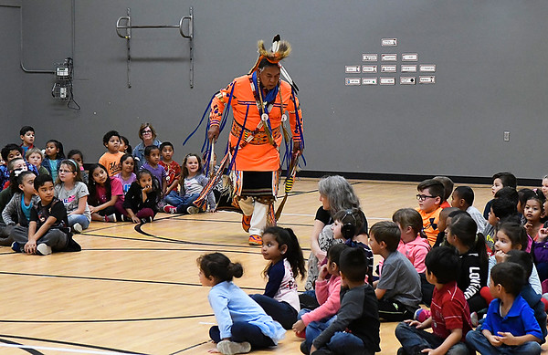 Zackk Morris performs a native American dance for students at Coolidge Elementary Friday November 17, 2017. (Billy Hefton / Enid News & Eagle)