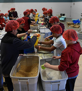Waller Middle School students fill bags of food as part of the Stamping out Starvation project Thursday November 16, 2017. (Billy Hefton / Enid News & Eagle)