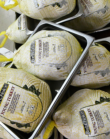 Pans of turkeys at the Knights of Columbus building Friday November 17, 2017. The turkeys will be served during the annual free meal Thanksgiving day 11 a.m. to 1 p.m. at Leven Center at St. Francis Xavier Catholic Church. (Billy Hefton / Enid News & Eagle)