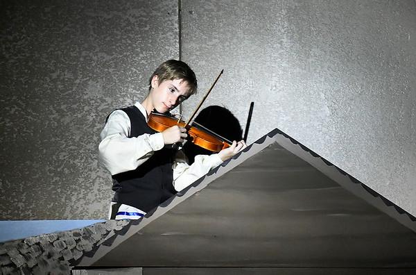 Ian Eastin rehearses in the Oklahoma Bible Academy production of Fiddler on the Roof Thursday November 16, 2017. (Billy Hefton / Enid News & Eagle)