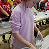 Waller Middle School student, Karsen Nunley, weighs a bag of food as part of the Stamping out Starvation project Thursday November 16, 2017. (Billy Hefton / Enid News & Eagle)