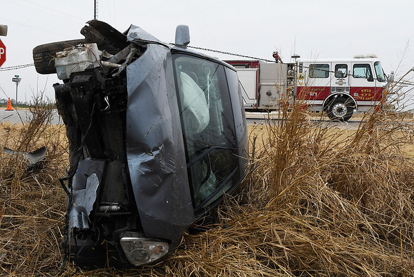 A vehicle rest on it's side following an accident at the intersection of US 412 and 114th street Monday November 6, 2017. (Billy Hefton / Enid News & Eagle)
