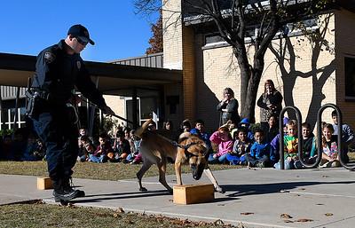 Enid K-9 officer Cody Smith and Fett do a drug detection demonstration at Monroe Elementary Wednesday November 15, 2017. (Billy Hefton / Enid News & Eagle)