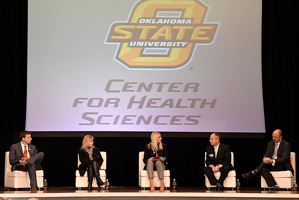 Panelist (left to right) Dr. Jason Beaman, Carrie Slatton-Hodges, Dr. Kayse Shrum, Jeffery Hickman and John Woods during the Addiction in Rural Oklahoma Summit on the opioid crisis Wednesday November 8, 2017 at the Central National Bank Center. (Billy Hefton / Enid News & Eagle)