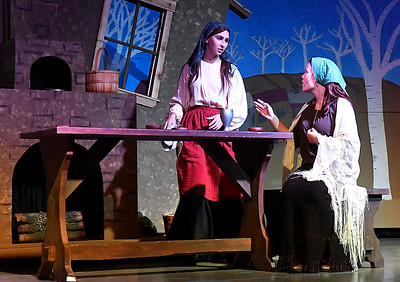 Katryn Kroeker and Sterling Nigh rehearse a scene in the Oklahoma Bible Academy production of Fiddler on the Roof Thursday November 16, 2017. (Billy Hefton / Enid News & Eagle)