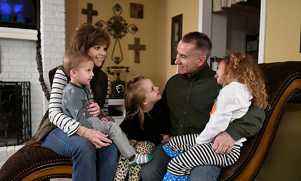 Bob and Gayla with their adopted children Kennedy, Castyn and Kannon Monday November 20, 2017. (Billy Hefton / Enid News & Eagle)
