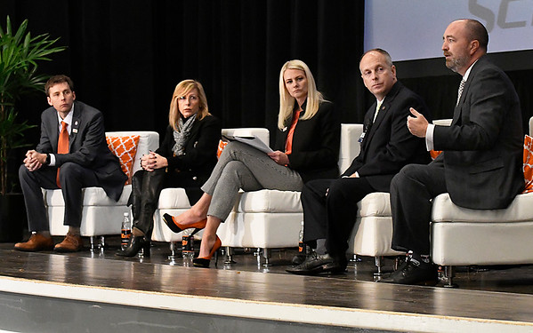 John Woods (right) gestures as he speaks to the audience and fellow panelist (left to right) Dr. Jason Beaman, Carrie Slatton-Hodges, Dr. Kayse Shrum and Jeffery Hickman during the Addiction in Rural Oklahoma Summit on the opioid crisis Wednesday November 8, 2017 at the Central National Bank Center. (Billy Hefton / Enid News & Eagle)