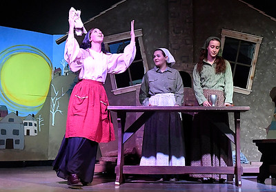 Katryn Kroeker (left), Isabel Giles and Sage Kroeker rehearse a scene in the Oklahoma Bible Academy production of Fiddler on the Roof Thursday November 16, 2017. (Billy Hefton / Enid News & Eagle)