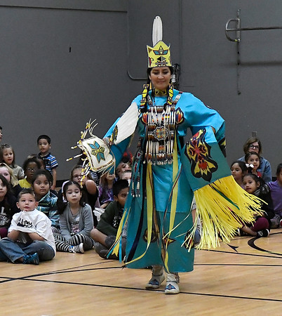 Kricket Connywerdy performs a native American dance for students at Coolidge Elementary Friday November 17, 2017. (Billy Hefton / Enid News & Eagle)